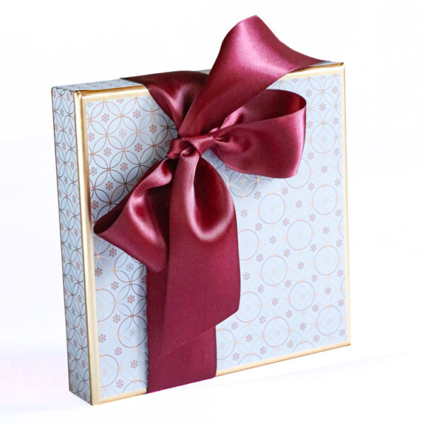 Medium Box of Chocolates wrapped in Luxury Christmas Paper collection - Light Blue